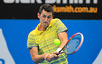 Bernard Tomic of Australia hits a backhand to Blaz Kavcic of Slovenia during their men's singles match at the Sydney International tennis tournament, Jan. 8, 2014.  IMAGE RESTRICTED TO EDITORIAL USE ONLY. Photo by Daniel Munoz/VIEWpress