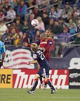 New England Revolution defender Seth Sinovic (27) and Real Salt Lake forward Alvaro Saborio (15) battle for head ball. Real Salt Lake defeated the New England Revolution, 2-1, at Gillette Stadium on October 2, 2010.