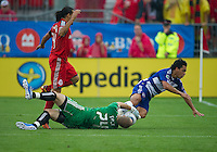July 24, 2010  FC Dallas midfielder Bruno Guarda #8 charges the net as Toronto FC goalkeeper Stefan Frei #24 makes the save during a game between FC Dallas and Toronto FC at BMO Field in Toronto..Final score was 1-1.