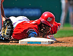 20 June 2010: Washington Nationals' outfielder Nyjer Morgan dives safely back to first in a pickoff attempt by the Chicago White Sox at Nationals Park in Washington, DC. The Nationals were swept by the White Sox falling 6-3 in the last game of their 3-game interleague series. Mandatory Credit: Ed Wolfstein Photo