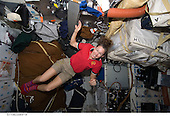 In Earth Orbit - March 21, 2009 -- Astronaut Sandra Magnus, STS-119 mission specialist, is pictured on the middeck of Space Shuttle Discovery while docked with the International Space Station..Credit: NASA via CNP
