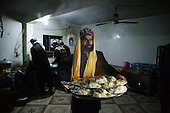 BIARA, IRAQ: Bahajat, a teacher at the madrassa, carries food into the mosque for the students...The Biara Madrassa--a religious school--is located high up in the mountainous Kurdish Hawraman region that makes up the Iran/Iraq border. Before 2003 the region was home to a fundamentalist Islamic group called Ansar al-Islam who used the school as a base. The Unites States military attacked the area and the madrassa numerous times during the 2003 invasion, finally pushing Ansar al-Islam out...Today the madrassa is home to 48 male students from all across Kurdish Iraq. The students leave their families and immerse themselves in their studies and the daily life of Koranic students...Photo by Besaran Tofiq