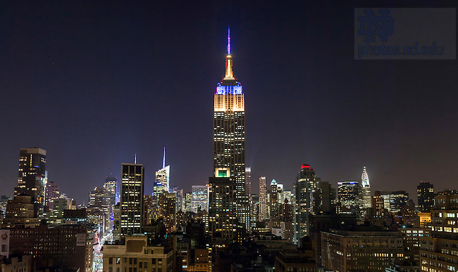 Dec. 27, 2013; The Empire State Building in New York City is lit with blue and gold lighting to mark the 2013 Pinstripe Bowl game between Notre Dame and Rutgers.<br /> <br /> Photo by Matt Cashore