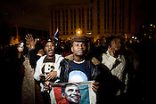 Rosamond Bankole, 25, of Durham, center, and Jenny Ingabire, 22, witness the winning returns for Barack Obama during the Barack 'N' Roll celebration in downtown Durham, Tues., Nov. 4, 2008.<br /> Photograph by D.L. Anderson