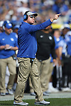 Head coach Mark Stoops of the Kentucky Wildcats yells a command at his team during the first half of the TaxSlayer Bowl against the Georgia Tech Yellow Jackets at EverBank Field on Saturday, December 31, 2016 in Jacksonville, Florida. Photo by Michael Reaves | Staff.