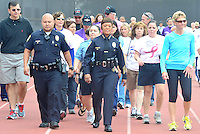 Santa Monica Police Chief Jacqueline Seabrooks (center) leads walkers during  the 10th annual American Cancer Society?s Relay For Life at Santa Monica College's Corsair Field on Saturday June 2, 2012.  Teams walk for 24 hours around Corsair Field to fight cancer, increase awareness of the disease and raise much-needed funds to support the services of the American Cancer Society.  The American Cancer Society Relay For Life is an international event..