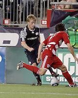 New England Revolution defender Seth Sinovic (27) changes direction as FC Dallas defender Heath Pearce(4) runs to tackle him.  The New England Revolution drew FC Dallas 1-1, at Gillette Stadium on May 1, 2010