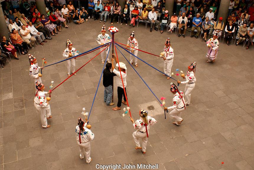 Traditional indigenous folk dancers performing in the Casa de la Cultura, city of Puebla, Mexico
