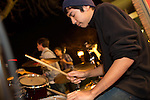AJ Pelayo of the Los Altos rock band 37th Parallel plays the drums during the February First Friday in downtown Los Altos.