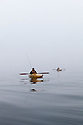 WA09195-00...WASHINGTON - Phil Russell and Luke Johansen kayak fishing on a foggy morning in the Strait of Juan de Fuca. (MR# R8  J9)