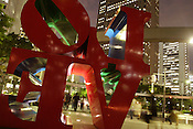 The 'LOVE' sculpture by Robert Indiana, stands in the skyscraper business district of Nishi-Shinjuku, Tokyo, Japan.