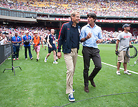 Germany head coach Joachim Loew and United States head coach Jurgen Klinsmann enter the field together before the game at RFK Stadium in Washington DC.  The USMNT defeated Germany, 4-3, in a friendly match.