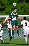 1 September 2009: Siena College Saints' forward Bobby Di Filippo, a Senior from West Nyack, NY, jumps high to head the ball away from the University of Vermont Catamounts at Centennial Field in Burlington, Vermont. The Saints edged out the Catamounts 1-0. Mandatory Photo Credit: Ed Wolfstein Photo