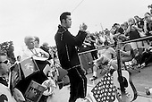 Memphis, Tennessee<br /> USA<br /> August 15, 2002<br /> <br /> An Elvis impersonator performing &quot;Jail House Rock&quot; before some 50, 000 Elvis fans from around the world gathered outside of Graceland for a candle vigil to mark the 25th anniversary of Elvis Presley's death.