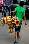 """An Egyptian boy carries Traditional Lanterns known as """"Fanous"""" in Arabic at a market ahead of the Muslim holy month of Ramadan in Cairo, Egypt, on May 21, 2017. Photo by Amr Sayed"""