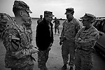 Iraq commander General David Petraeus inspects the work of Army Special Forces soldiers tasked to train potential Iraqi S.W.A.T. police officers at Camp Echo in ad-Diwaniyah. The visit was took place during a visit by Petraeus -   and his immediate subordinate Lt. General ? Odierno - to attend a change of command ceremony for rotating Polish units in ad-Diwaniyah, a majority Shiia city in southern Iraq. The incoming Polish unit will be the last Polish force to serve in Iraq after Warsaw announced plans to withdraw its troops in the fall. The Polish have third largest national contingent serving in Iraq after the US and Great Britain.