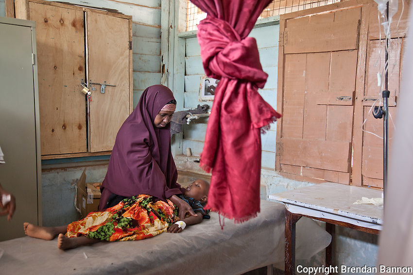 A mother comforts her sick child in the emergency room at MSF's hospital in dadaab refugee camp.