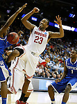 Terrence Jones blocks a shot by David Lighty in the Sweet 16 of the 2011 NCAA Basketball Tournament, at the Prudential Center, in Newark, NJ, on Saturday, March 25, 2011.  Photo by Latara Appleby | Staff