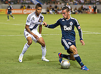 CARSON, CA - September 1, 2012: LA Galaxy defender Sean Franklin (5) and Vancouver midfielder Russell Teibert (31) during the LA Galaxy vs the Vancouver Whitecaps FC at the Home Depot Center in Carson, California. Final score LA Galaxy 2, Vancouver Whitecaps FC 0.