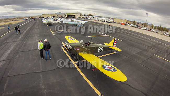 Open House at the WInnemucca Airport as photographed using the DJI Phantom quadcopter drone and GoPro Hero 3 camera from above the event. <br /> <br /> Aircraft on the ramp with Rocky Phoenix's homebuilt Stewart Bowers Flybaby open-cockpit monoplane in 1930s U.S. Army paint