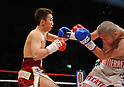 (L-R) ^¾¶--²?°/Takahiro Aou (JPN), Humberto Mauro Gutierrez (MEX),..APRIL 8, 2011 - Boxing :..Takahiro Aou of Japan in action against Humberto Mauro Gutierrez of Mexico during the WBC super featherweight title bout at World Memorial Hall in Kobe, Hyogo, Japan. (Photo by Mikio Nakai/AFLO)