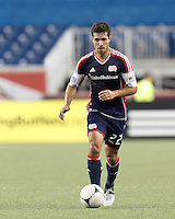 New England Revolution forward Benny Feilhaber (22) brings the ball forward. In a Major League Soccer (MLS) match, Toronto FC defeated New England Revolution, 1-0, at Gillette Stadium on July 14, 2012.