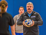 26 October 2014: Yeshiva University Maccabee Head Coach Joseph Agrest, instructs team members prior to a game against the College of Mount Saint Vincent Dolphins, in Riverdale, NY. The Dolphins defeated the Maccabees 3-0 in the NCAA Division III Women's Volleyball Skyline matchup. Mandatory Credit: Ed Wolfstein Photo *** RAW (NEF) Image File Available ***