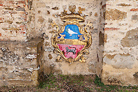 A gilded coat of arms is just one of the artistic conceits which make up La Scarzuola