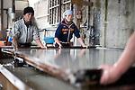 Artisans make washi paper at Iwano Heizaburo Seijijo in Echizen, Fukui Prefecture, Japan on 21 Feb. 2013. Photographer: Robert Gilhooly  .Artisans tilt a frame to create an even sheet of washi paper at Iwano Heizaburo Seijijo in Echizen, Fukui Prefecture, Japan on 21 Feb. 2013. Photographer: Robert Gilhooly    .