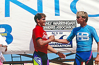 North Narrabeen, Sydney, New South Wales, Australia. Kelly Slater (USA), winner of the 1992 Ocean and Earth Hot Buttered Pro Junior at North Narrabeen beach is congratulated by his good friend and second place finisher  Shane Dorian (HAW). Slater was the first foreign surfer to win the prestigious event. Photo: joliphotos.com
