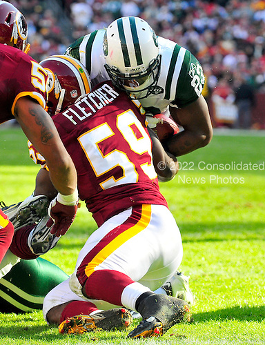 New York Jets running back Shonn Greene (23) is stopped short of the goal line by Washington Redskins linebacker London Fletcher (59) in the first quarter at FedEx Field in Landover, Maryland on Sunday, December 4, 2011.  The Jets won the game 34 - 19..Credit: Ron Sachs / CNP.(RESTRICTION: NO New York or New Jersey Newspapers or newspapers within a 75 mile radius of New York City)