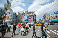 A billboard advertising the Calvin Klein brand featuring Kate Moss and artist Frank Ocean in the Soho neighborhood of New York on Friday, July 8, 2016. Klein's advertisements use sex and provocative images to test society's cultural and moral boundaries. (© Richard B. Levine)