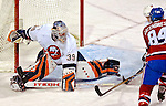 3 February 2007: New York Islanders goaltender Rick DiPietro (39) makes a toe save in the third period against the Montreal Canadiens at the Bell Centre in Montreal, Canada. The Islanders defeated the Canadiens 4-2.Mandatory Photo Credit: Ed Wolfstein Photo *** Editorial Sales through Icon Sports Media *** www.iconsportsmedia.com