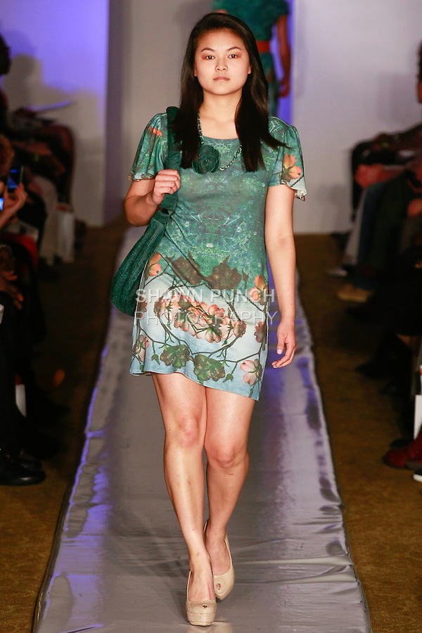 Model walks runway in an outfit from the Provocation Designs Fall 2012 Ophelia's Soliloquy collection, by Kristina Benshoff, during Plitzs Fashion Week New York Fall 2012.