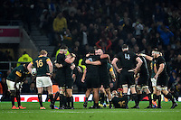 New Zealand players celebrate at the final whistle. Rugby World Cup Semi Final between South Africa and New Zealand on October 24, 2015 at Twickenham Stadium in London, England. Photo by: Patrick Khachfe / Onside Images