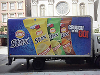 "A delivery truck advertises Lay's ""Stax"" on the go snack food on Thursday, July 3, 2014. (© Richard B. Levine)"
