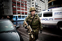 Oslo, Norway, 25.07.2011. A member of the norwegian armed forces in downtown Oslo. On 22 July 2011, Anders Behring Breivik bombed the government buildings in Oslo, which resulted in eight deaths. He then carried out a mass shooting at a camp of the Workers' Youth League (AUF) of the Labour Party on the island of Ut&oslash;ya where he killed 69 people, mostly teenagers. Photo: Christopher Olss&oslash;n. ..----------------------------..-ITALY OUT-..----------------------------