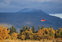 Bush plane on floats flys over Katmai National park, Alaska