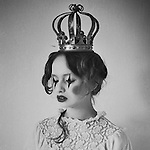 Young adult female with clown makeup and crown