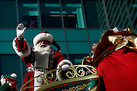 USA, New York, Nov 28, 2013. Santa Claus waves to the crowd while people take part in the 87th Macy's Thanksgiving Day Parade in New York City. Photo by VIEWpress/Eduardo Munoz Alvarez