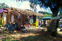 People outside surf and swimwear shops along Oahus north shore