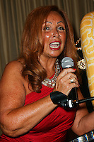 BEVERLY HILLS, CA, USA - MARCH 28: Tina Trozzo at the Versace Unveiling Of The 1st Pop Recording Artist Superhero - KUBA Ka's Performance Outfits. Designed by the legendary fashion hosuse - Donatella Versace. For the Benefit of the Face Forward Foundation (Plastic Surgery for Destroyed Faces from Violence). Pop entertainer TV personality KUBA Ka, together with VERSACE, unveiled Kuba Ka's new Versace images, for the First Pop Artist/Superhero of the World. He has become the inspiration of Donatella's newest and wildest creations and will celebrate the launch of his new power house conglomerate - KUBA Ka Empire Inc. in collaboration with the sensational fashion house - VERSACE on Friday, his birthday at a red carpet media and celebrity event at the luxurious Peninsula Hotel in Beverly Hills held at the Peninsula Hotel on March 28, 2014 in Beverly Hills, California, United States. (Photo by Xavier Collin/Celebrity Monitor)
