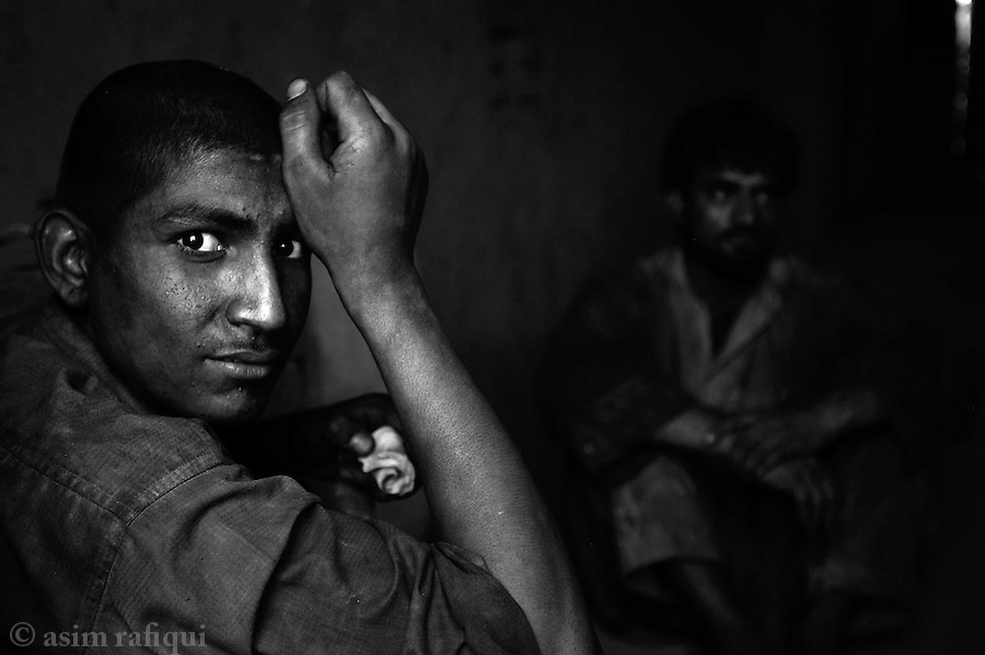 boys at the brick factory take their breakfast.  the day normally begins at 6:00am and the men take a break for breakfast around 8:00am.  jalozai, peshawar, pakistan.  september 2003&amp;#xA;&amp;#xA;copyright asim rafiqui 2003<br />