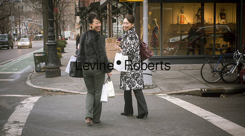 Asian women tourists shopping on Bleecker Street in New York on Wednesday, January 30, 2013. (© Richard B. Levine)
