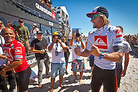 """LONG BEACH, Long Island/New York (Friday, September 9, 2011) - Owen Wright (AUS), 21, has claimed his maiden ASP Dream Tour victory, taking out the inaugural Quiksilver Pro New York over Kelly Slater (USA), 39, to earn the historic US $300,000 first-place prize purse in offshore three-to-five foot (1 - 1.5 metre) surf at Long Beach, New York.. .The Quiksilver Pro New York Final marked a rematch between the two from the last stop on the ASP World Title Series in Teahupo'o, but today proved  to be Wright's day, claiming revenge on Slater in front of the capacity crowd in New York.. .Wright wasted no time in the Final, belting a 7.00, a 9.23, and an 8.00 in the opening minutes of the heat against the Floridian with a savage forehand attack on the clean lefthand walls, setting the bar too high for the reigning 10-time ASP World Champion to overcome.. .""""I'm just lapping it up right now,"""" Wright said. """"I've always wanted to be in Final with Kelly (Slater) and last week at Teahupo'o was great. I think Kelly is ready for payback already. Thank you Long Beach, how good is this? Look at these waves! Thanks to Quiksilver, we've been looked after all week and they made it really easy for us and thanks for the $300,000. Thanks to my coach Dean Davies, it's been up and down and we've worked towards a win and it means a lot. Thanks to my friends and family at home. I've been getting messages from them and my Dad, I wish he was here, but another day. Thanks heaps, I really appreciate the support."""". .The Australian's win moves him to No. 2 on the ASP World Title rankings and is now within striking distance of his first ASP World Title..   Photo: joliphotos.com"""
