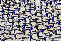 Students do morning exercise in Hetian Experimental Billingual School, in Hetian, Xinjiang province, China, on October 13, 2006. The Uyghur people are a Turkic ethnic group living mainly in the Xinjiang Uyghur Autonomous Region of China. Photo by Lucas Schifres/Pictobank