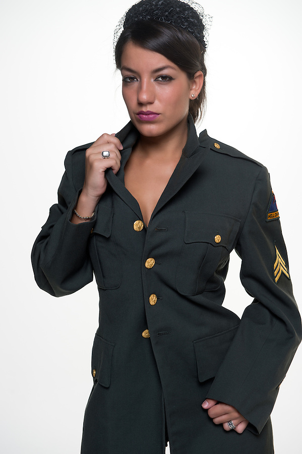 Woman looking at camera in military clothing