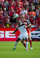 17 September 2011: Colorado Rapids forward Omar Cummings #14 and Toronto FC defender Ty Harden #20 in action during an MLS game between the Colorado Rapids and the Toronto FC at BMO Field in Toronto, Ontario Canada..Toronto FC won 2-1.