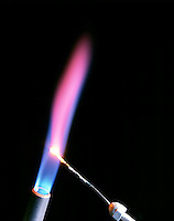LITHIUM FLAME TEST<br /> (Variations Available)<br /> Magenta Flame Shows Presence Of Lithium (Alkali metal)<br /> Lithium compound is dissociated by flame into gaseous atoms, not ions. The atoms of the element are raised to excited state by high temperature of flame. Excess energy from the atom is emitted as light of a characteristic wavelength.