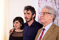 Italian journalist Gabriele Del Grande, center, flanked by his companion Alexandra D'Onofrio, left, and Senator Luigi Manconi, poses before to start a press conference at the Foreign Press Association in Italy's headquarters in Rome, April 25, 2017, the day after his return from Turkey, where he had been detained for 2 weeks.<br /> UPDATE IMAGES PRESS/Riccardo De Luca